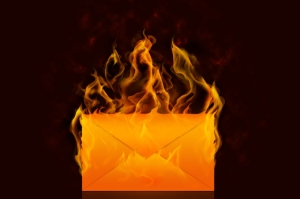 hate mail letter envelope on fire